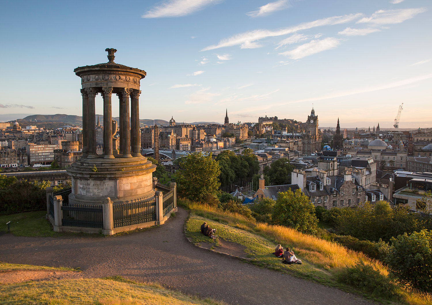 Looking across Edinburgh from Calton hill, with the Dugald Stewart Monument in the forground.